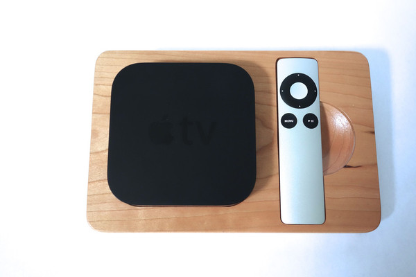 Cherry bloc with Apple TV and remote in holder