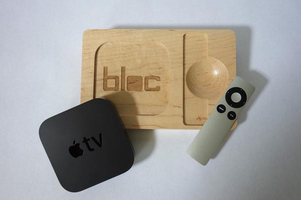 Hard Maple exploded view of Apple TV and remote pieces