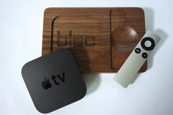 Walnut exploded view of Apple TV and remote pieces