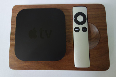 Walnut bloc with Apple TV and remote in spots